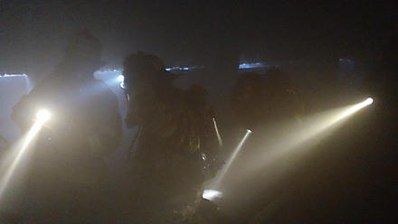 firefighting crew carries out search- and-rescue operation