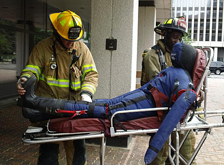 firefighters rescuing victim