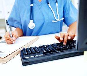 nurse at computer