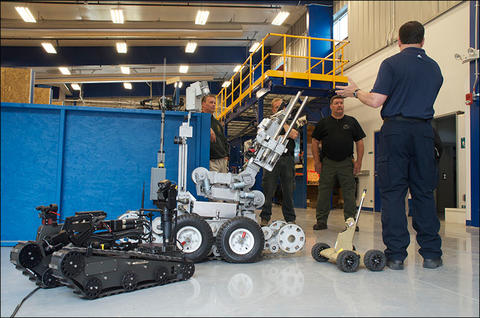 NIST engineer Adam Jacoff with Bomb Squad and robots