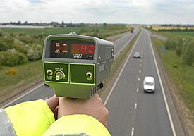 police officer uses radar device
