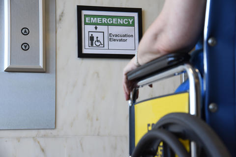Image of a wheelchair in front of an elevator