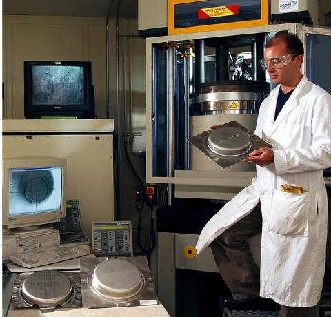 NIST researcher with metal stamping equipment