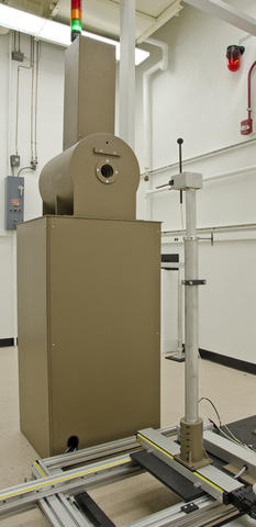 The cesium-137 is enclosed in the brown metal irradiator unit.