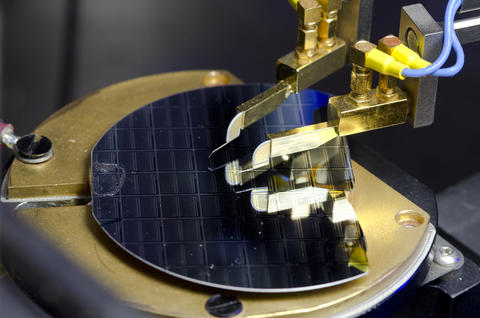 A graphene-insulator-semiconductor sample under electrical test.
