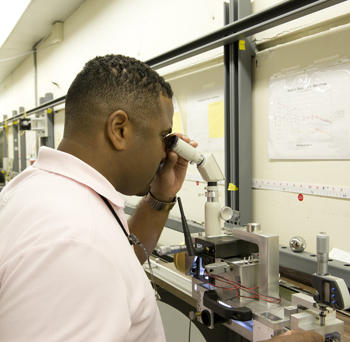 Daniel Sawyer makes a measurement using the interferometer.