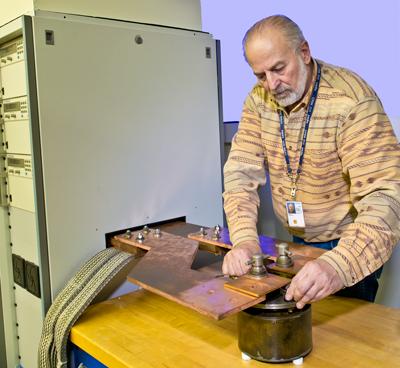 Marlin Kraft adjusts a current shunt connection.