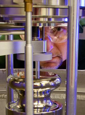 Patrick Abbott examines apparatus.