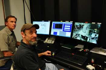 Paul Williams and Joshua Hadler operating the NIST calibration service for high-power lasers.