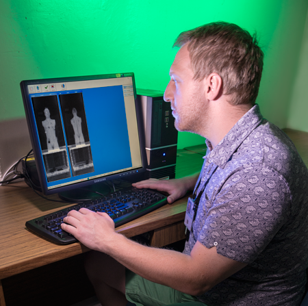 NIST researcher Jack Glover with a scanner image of the phantom