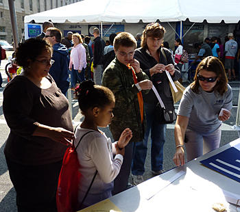visitors to the NIST booth at USA Science & Engineering Expo