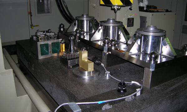 Three of the four James Webb Space Telescope Primary Mirror Backplane Support Structure fixtures on the NIST M48 Coordinate Measuring Machine.