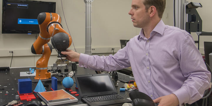 Jeremy Marvel adjusts robotic arm