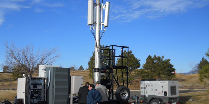 Photo of NIST scientists with the PSCR Deployable LTE Cell-on-Wheels