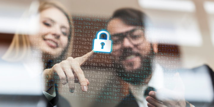 Employees pressing a lock icon representing cybersecurity