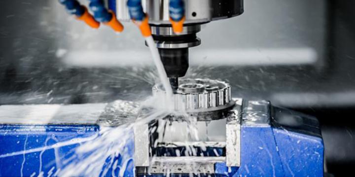 CNC machine working in a manufacturing facility