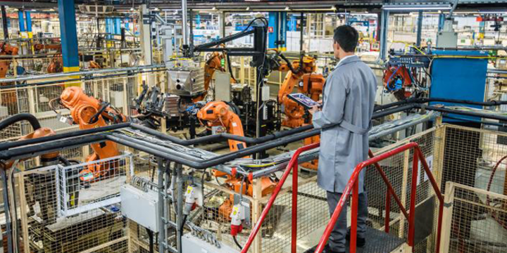 manufacturer looking at automation in a manufacturing facility