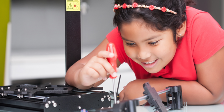 girl working on a 3D printer