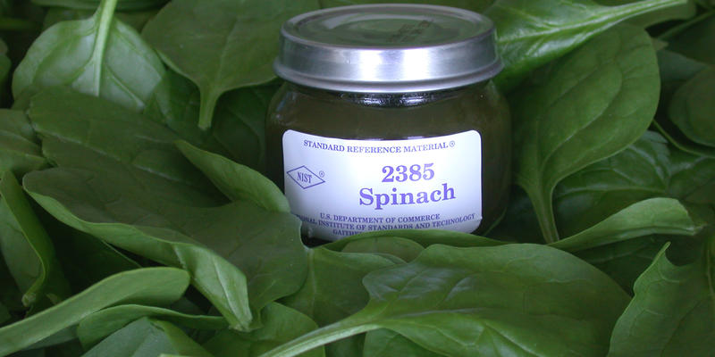 photo of NIST SRM 2385, spinach, on background of spinach leaves