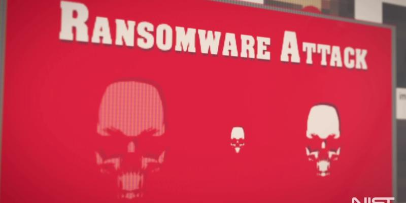 "Still from ransomware video shows red computer screen with skulls and header ""Ransomware Attack."""
