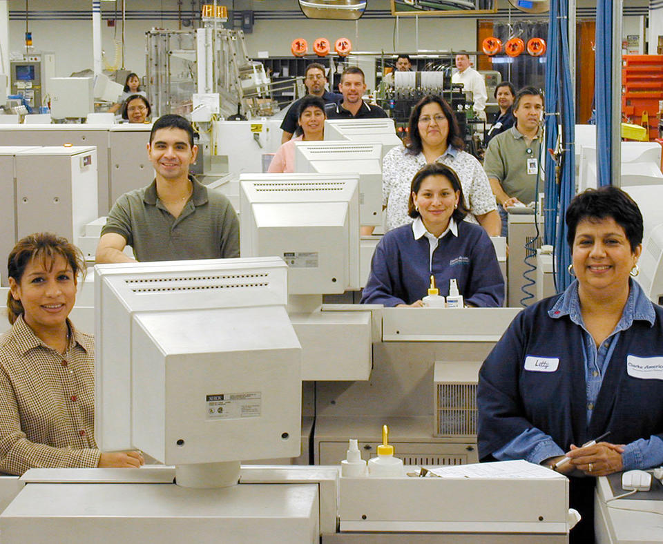 Clarke American Checks, Inc. photo of manufacturing employees.