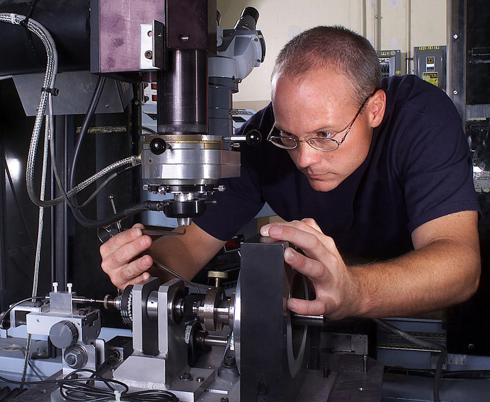 Honeywell Federal Manufacturing & Technologies, LLC photo of employee working on components.