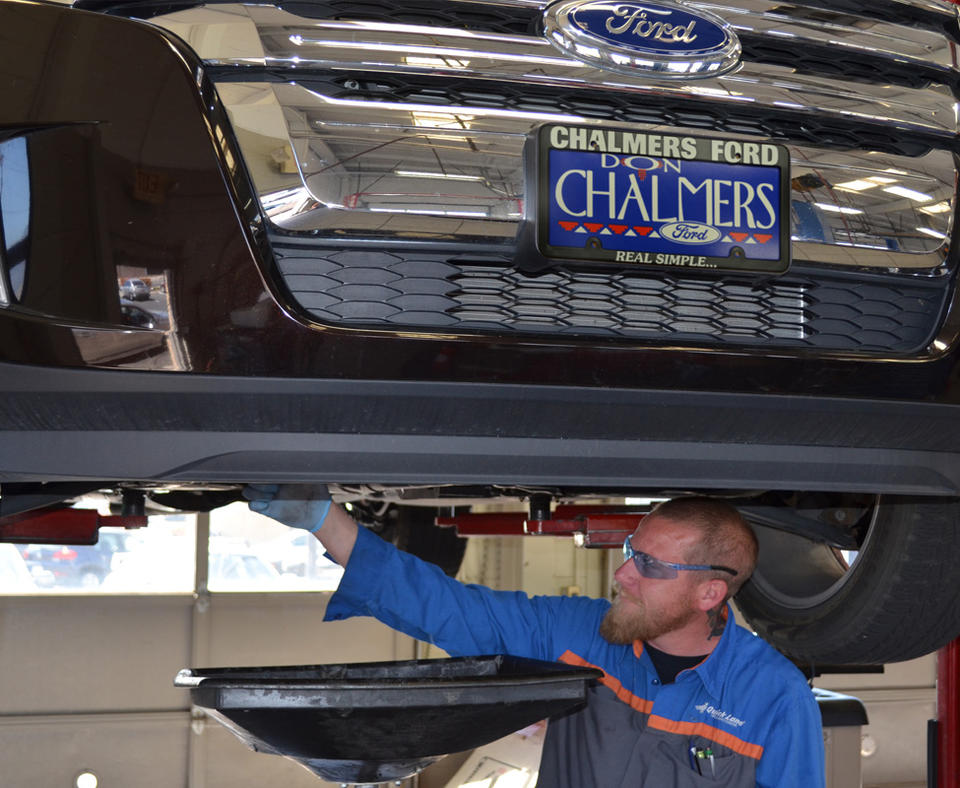 Photo of Don Chalmers Ford mechanic working on a vehicle.