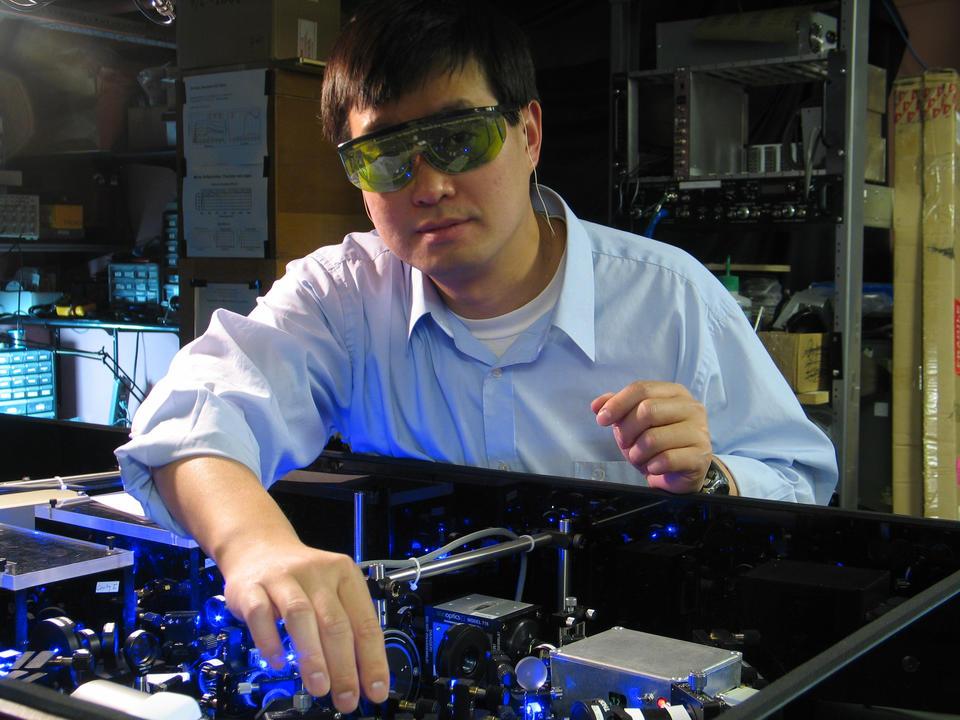 Photo of NIST physicist Jun Ye with his strontium atomic clock