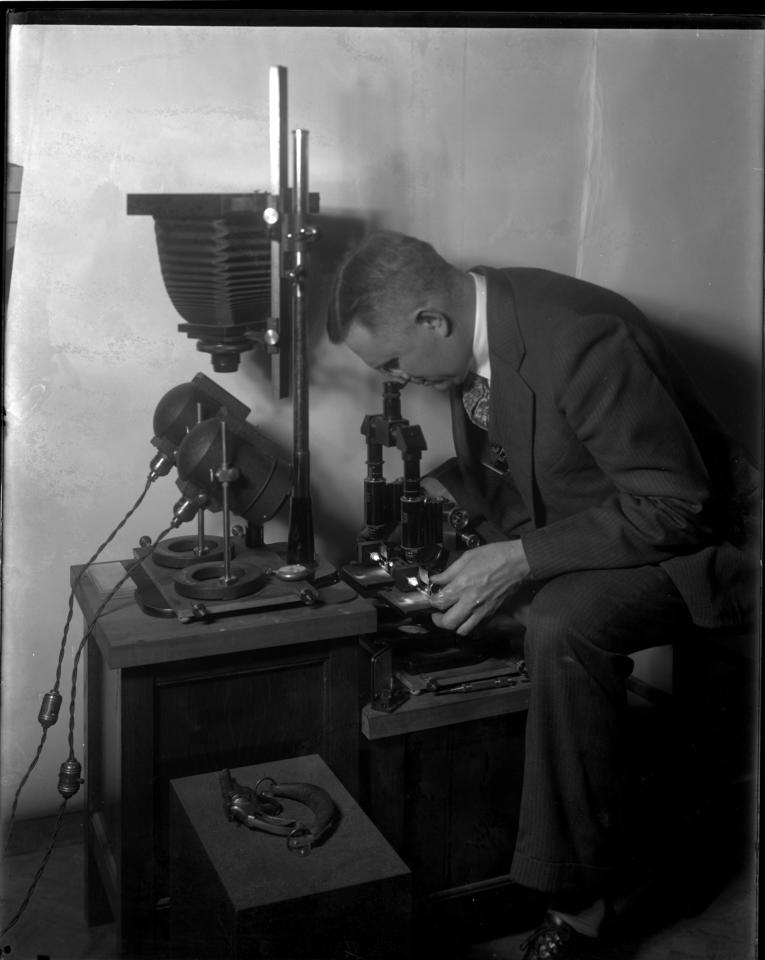 Wilmer Souder using an early comparison microscope