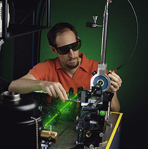 Electrical engineer Richard Mirin aligns a laser