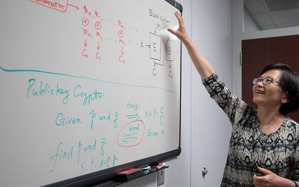 Lily Chen at her whiteboard