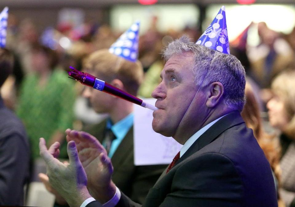 """UW–Stout Chancellor Bob Meyer celebrates employee ideas alongside other audience members at the university's annual """"You Said, We Did"""" event in January 2015."""