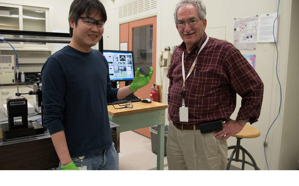 Two men standing in lab