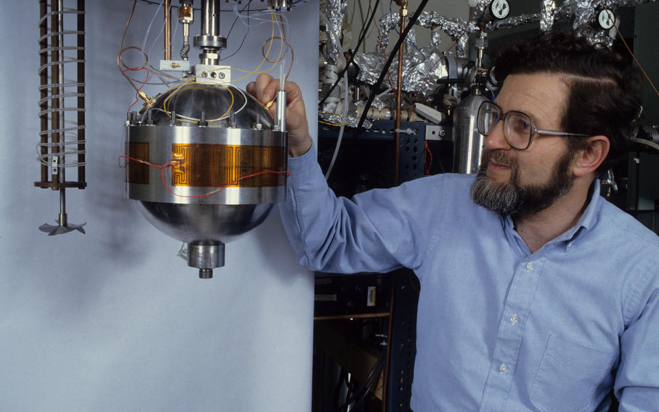 NIST researcher Mike Moldover with a basketball-sized metal sphere used to measure the speed of sound in a gas
