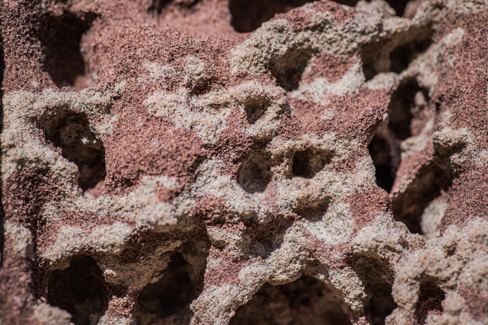 Asteroid-like landscape formed of red and gray sandstone from Marquette, Michigan