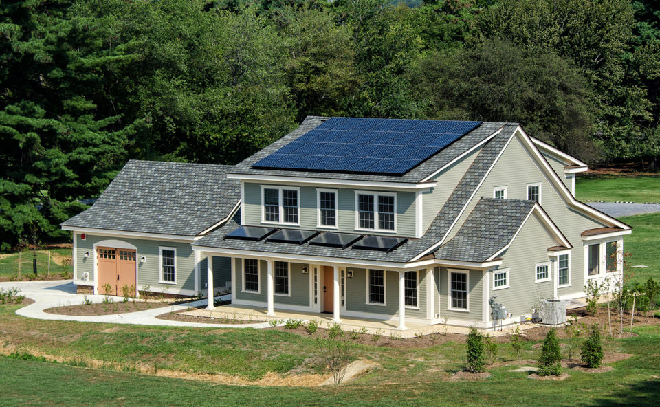 photo of a house. Solar panels on the roof.