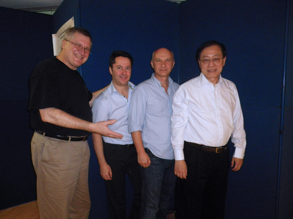 2011 picture from left to right of Charles Clark, Ignacio Cirac, Artur Ekert, and Andrew Chi-Chih Yao