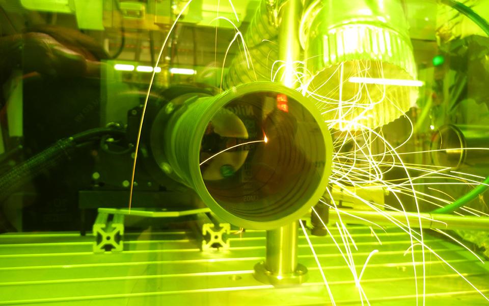 a laser cuts through a pipe