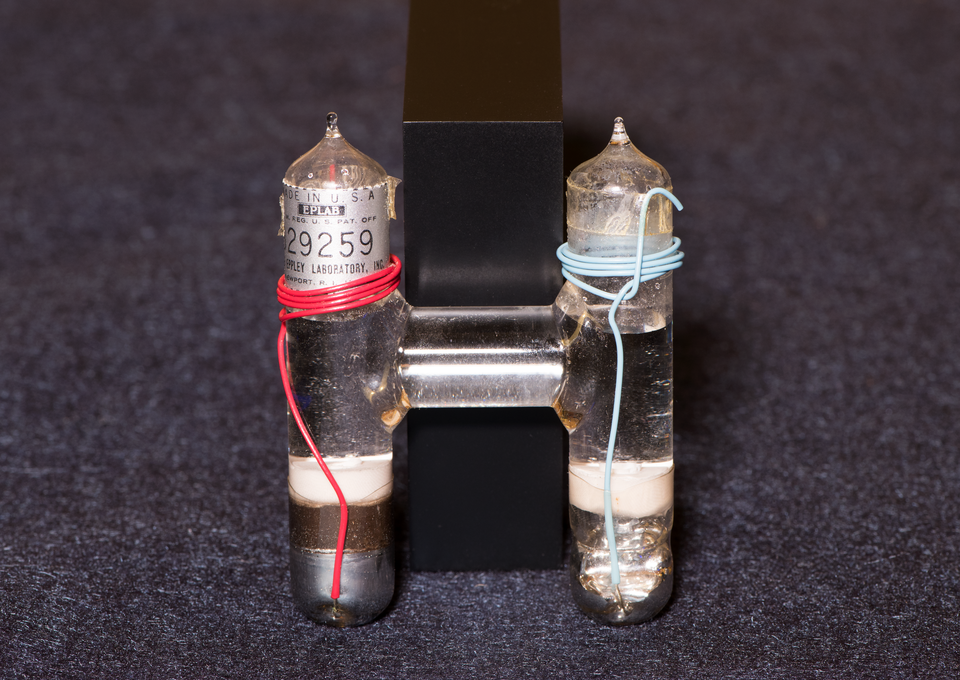 inside of a Weston cell. Two cylinders, one with red wire, one with blue wire