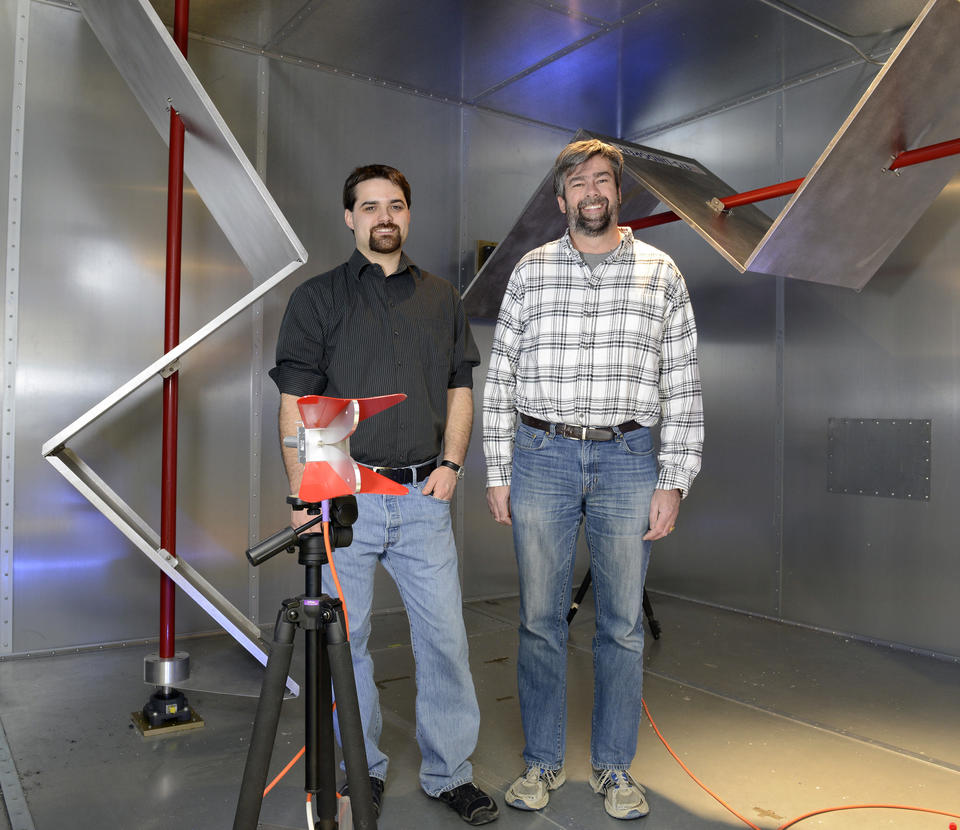Two men in a reverb chamber