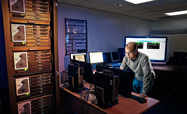 Murugiah Souppaya works in a computer lab at the National Cybersecurity Center of Excellence.