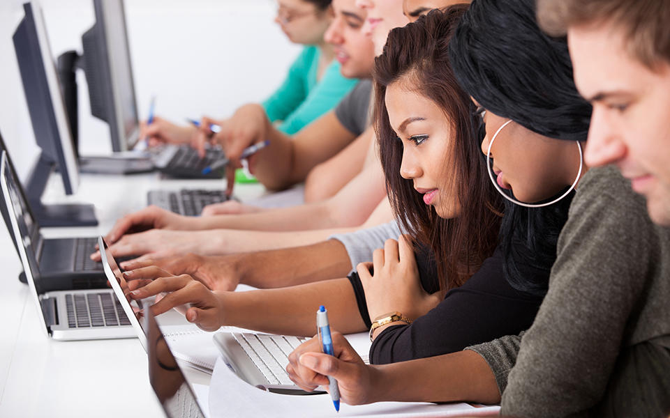students at their computers learning about cybersecurity