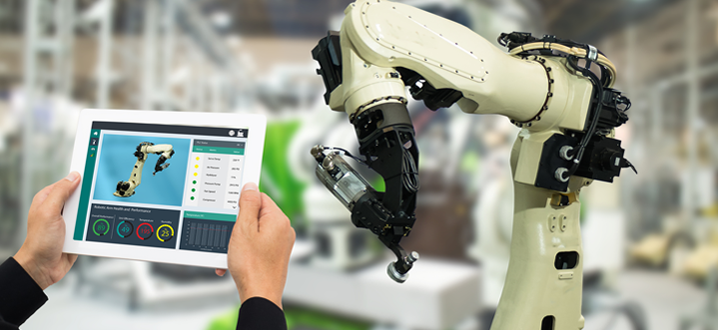 manufacturer with an ipad controlling a robot