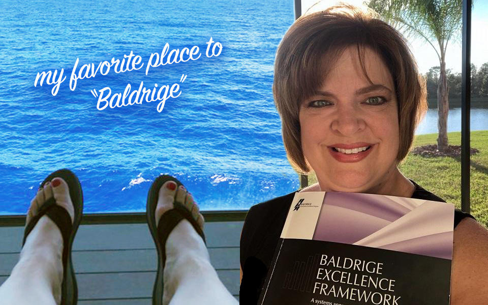 "Baldrige Examiner Theresa Trivette holding a Baldrige Excellence Framework Health Care in Florida at the beach her favorite place to ""Baldrige""."