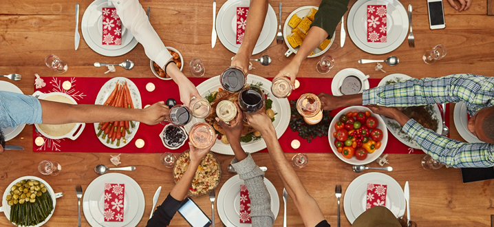 holiday gathering at a table with food and place settings