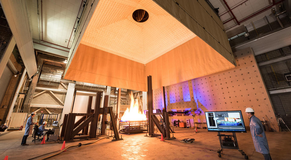 NIST engineers operate various imaging systems to document a structure's behavior during a fire test.