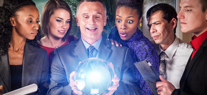 business people looking at a crystal ball