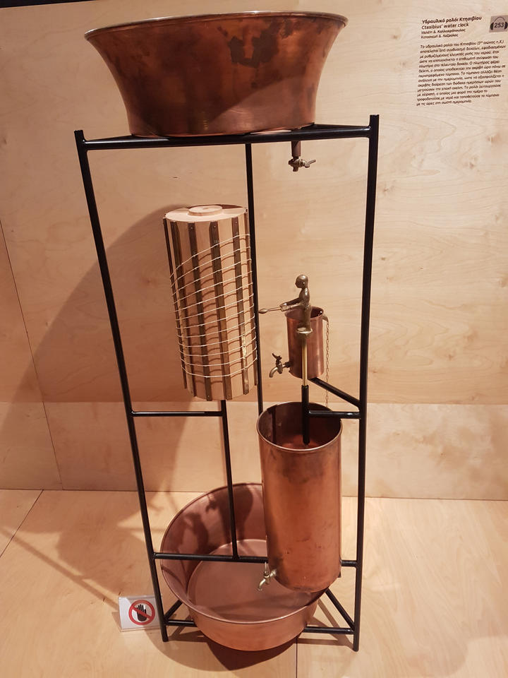 photo of a water clock in a museum