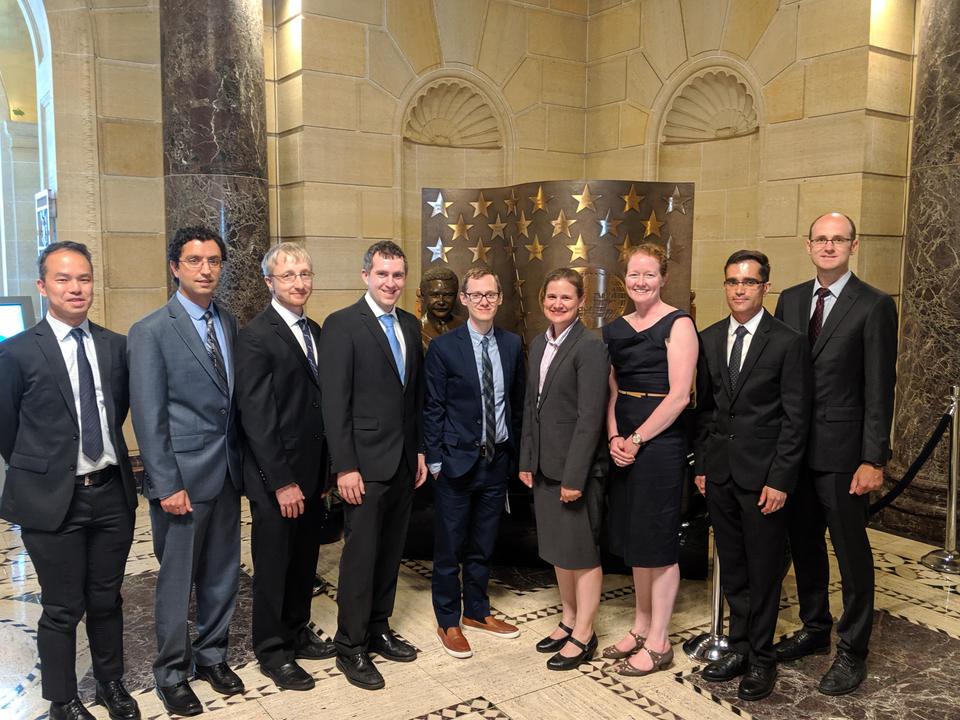 Nine award winners pose for a group photo