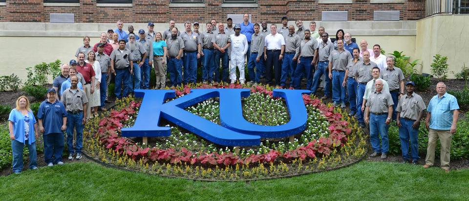 photo outdoors featuring group of facilities workers